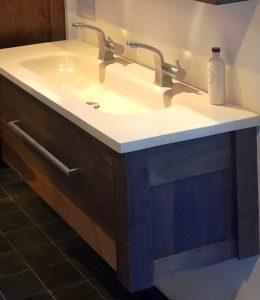 Solid stainless steel Wave mixer taps on marble Horizon inset basin